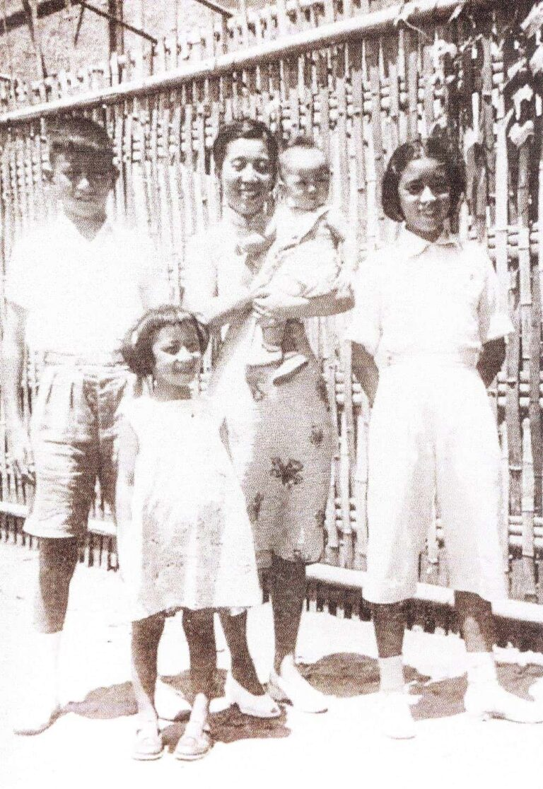 Xi Xi (right) and her mother, brother, and sisters, before going to Hong Kong.